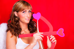 Valentine love shot by amor angel Royalty Free Stock Photos