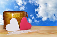 Valentine Love. A small heart shaped label on a wooden table  , clipping path included to remove the background with ease Royalty Free Stock Images
