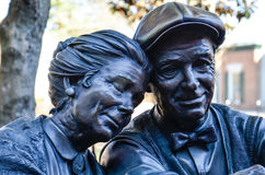Valentine, Main Street, Smithfield, VA. Bronze statue of couple Valentine in Main Street, Smithfield, VA, USA. Produced by sculptor George Lundeen Royalty Free Stock Images