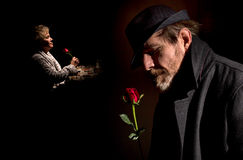 Valentine. A men and women reflecting over the years spent together.  Depicting the men about to give the rose thinking of his partner and the women after having Royalty Free Stock Photography