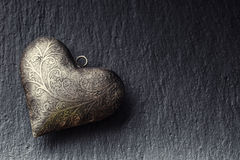 Valentine Metal heart on a granite board. Valentine's two silver heart with ornaments. Heart of Love Valentines and wedding Day. Royalty Free Stock Photography