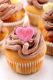 Valentine muffin with pink heart on white background Royalty Free Stock Photo