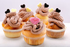 Valentine muffin with pink heart on white background Stock Photo