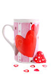 Valentine mug and hearts Royalty Free Stock Image