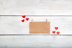 Valentine, a note on the kraft paper lies on a white wooden back Stock Images