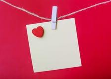 Valentine Note On Red Background Stockbilder