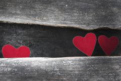 Valentine. Old wooden background Red heart on the table Royalty Free Stock Photos
