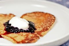 Valentine Pancake heart. Pancake with jam and cream on a white plate Royalty Free Stock Photography
