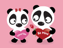 Valentine Pandas holding hearts Royalty Free Stock Images