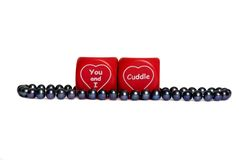 Valentine pearls. With a simple roll of the dice... You and I cuddle and your my valentine Royalty Free Stock Photography