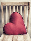 Valentine Pillow. On wooden chair Stock Photo