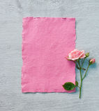 Valentine pink card with rose on wooden background. Royalty Free Stock Image