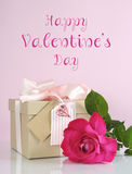 Valentine pink gift with rose and sample text Royalty Free Stock Photography