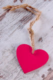Valentine pink heart with twine on old wooden white table, symbol of love Royalty Free Stock Photos