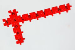 Valentine. Pink puzzle pieces showing words Happy Valentine Royalty Free Stock Image