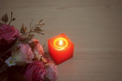 Valentine pink roses with flaming candle royalty free stock image