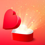 Valentine postcard with opened surprise red gift box and shine Stock Images