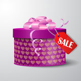Valentine red gift box with heart shapes Stock Photos