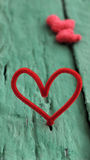 Valentine red heart on green background Royalty Free Stock Photography