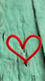 Valentine red heart on green background Royalty Free Stock Photo