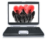 Valentine red heart on laptop Stock Photo