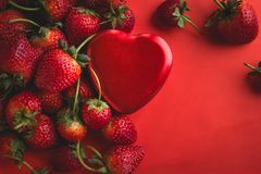 Valentine red heart and strawberry on red background Stock Photography