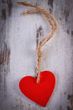 Valentine red heart with twine on old wooden white table, symbol of love Royalty Free Stock Photos