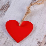 Valentine red heart with twine on old wooden white table, symbol of love Stock Photography