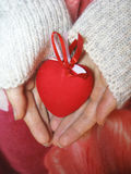 Valentine red heart in woman tender hands Royalty Free Stock Images