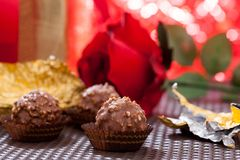 Red roses and chocolate. Valentine red roses and chocolate Stock Image