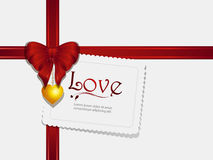 Valentine ribbon pendant and card Royalty Free Stock Photography