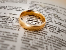 Valentine Ring. Wedding ring over a book with the word Valentine enhanced in the middle Stock Photos