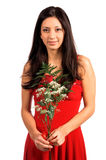 Valentine Rose. Beautiful latina woman in a red Valentine's Day dress with a red rose fern and baby's breath stock images