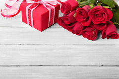Valentine roses and gift box on white wood, copy space Royalty Free Stock Photos