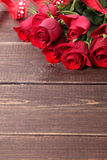 Valentine roses with red ribbon on wooden background Stock Photo