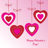 Valentine's background with four hearts. On pink phone Royalty Free Stock Photos