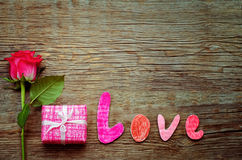 Valentine's background with gift, flower and word Love Stock Images