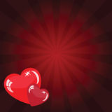 Valentine's background with red hearts. Valentine's background with two hearts on the red phone with rays Royalty Free Stock Photo