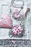 Valentines cake decorations on a spoon Royalty Free Stock Images