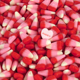 Valentine's Candy. Corn with a candy heart stock image