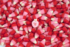 Valentine's Candy. Corn with a candy heart royalty free stock photo