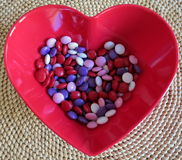 Valentine's candy. Pastel valentine's candy in a heart shape bowl means love royalty free stock photo