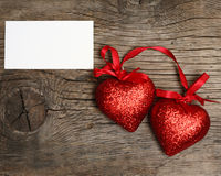 Valentine`s card. Two red hearts on old wooden background royalty free stock images
