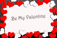 Valentine's card. Valentine's greeting card surrounded by red and white hearts Royalty Free Stock Photography