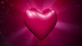Valentine's card. Rotating heart at flying hearts background stock video