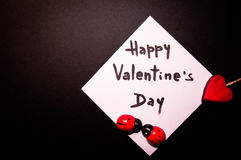 Valentine`s card on a black background royalty free stock photo