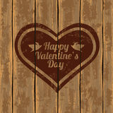 Valentine's card with heart. Valentine's greeting card. Illustration with heart on a retro wooden boards background Royalty Free Stock Images