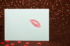 Valentine's card with a kiss. On a brilliant background with hearts Royalty Free Stock Images