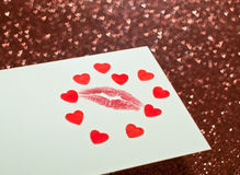 Valentine's card with a kiss. On a brilliant background with hearts Stock Image