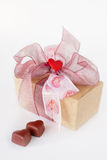 Valentine's chocolate box. Decorated valentine's chocolate box with two heart-shaped pralines on the front Stock Photography